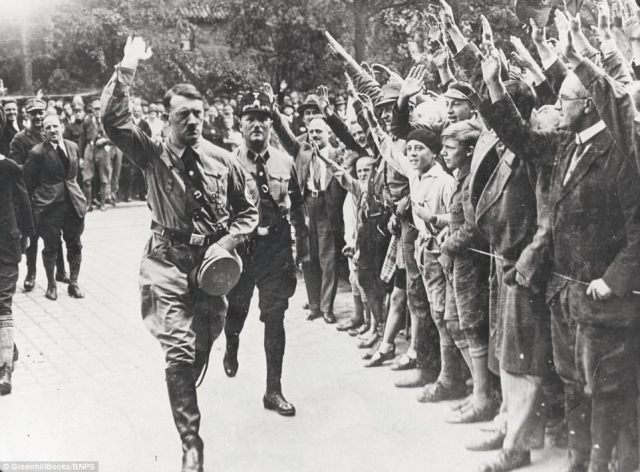 the-Fuehrer-saluting-followers.jpg